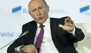 Russian President Vladimir Putin gestures while speaking at the plenary session of the an annual meeting of the Valdai International Discussion Club in the Black Sea resort of Sochi, Russia, Thursday, Oct. 19, 2017. (AP Photo/Alexander Zemlianichenko, pool)