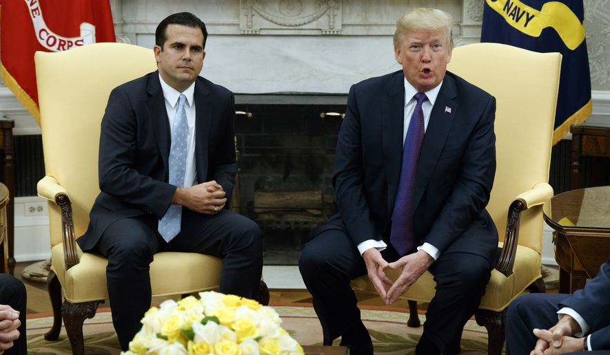 President Donald Trump speaks during a meeting with Gov. Ricardo Rossello of Puerto Rico in the Oval Office of the White House, Thursday, Oct. 19, 2017, in Washington. (AP Photo/Evan Vucci)