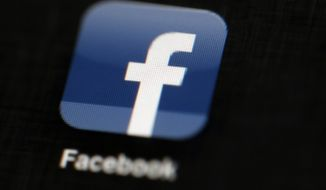 In this May 16, 2012, file photo, the Facebook logo is displayed on an iPad in Philadelphia. Senators are moving to boost transparency for online political ads, unveiling on Oct. 19, 2017, what could be the first of several pieces of legislation to try to lessen influence from Russia or other foreign actors on U.S. elections. (AP Photo/Matt Rourke, File)
