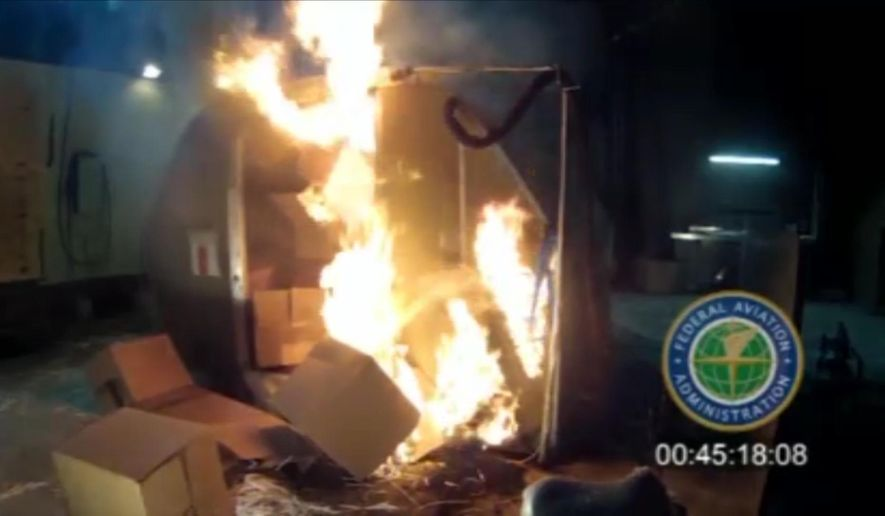 FILE - In this April 2014 file image frame grab from video, provided by the Federal Aviation Administration (FAA), a test at the FAAs technical center in Atlantic City, N.J. The U.S. government is urging that large, personal electronic devices like laptops be banned from airline checked luggage because of the potential for a catastrophic fire. (FAA via AP, File)