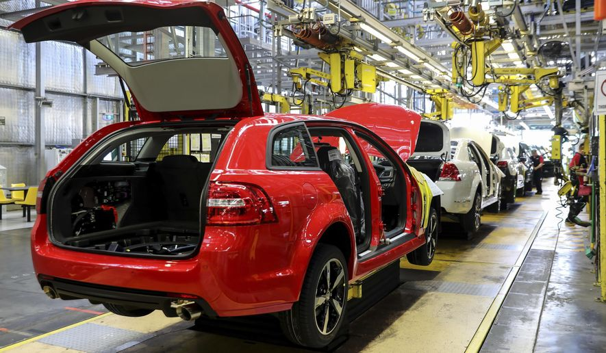 In this undated photo provided by General Motors Holden, cars are assembled on the production line in Adelaide, Australia.  The Australian auto manufacturing era ends after more than 90 years on Friday, Oct. 20, 2017 when General Motors Co.'s last Holden sedan rolls off the production line in the industrial city of Adelaide. The nation has already begun mourning the demise of a home-grown industry in an increasing crowded and changing global car market. (General Motors Holden via AP)