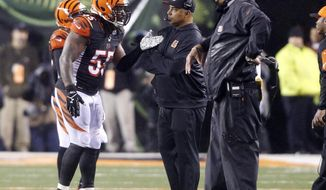FILE - In this  Jan. 10, 2016, file photo, Cincinnati Bengals head coach Marvin Lewis, center, talks with outside linebacker Vontaze Burfict (55) after a penalty during the second half of an NFL wild-card playoff football game against the Pittsburgh Steelers in Cincinnati. The Bengals return from their bye with the toughest stretch of their schedule right down the road. They play four of the next five away from home, starting with a pivotal game in Pittsburgh on Sunday(AP Photo/Frank Victores, File)