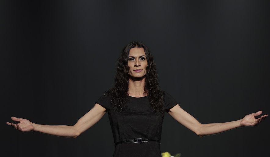 """In this Sept. 27, 2017 photo, transgender actress Renata Carvalho plays the role of Jesus in the play """"The Gospel According to Jesus, Queen of Heaven"""" in Sao Paulo, Brazil. The play in which Jesus is reimagined as a transgender woman who tells Biblical stories of tolerance has been performed more than 60 times during a tour of Brazil, but conservatives have called it offensive to Christians and petitioned courts to ban its performances. (AP Photo/Andre Penner)"""