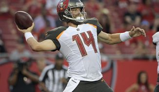 FILE - In this Aug. 31, 2017, file photo, Tampa Bay Buccaneers quarterback Ryan Fitzpatrick (14) throws a pass against the Washington Redskins during the first quarter of an NFL preseason football game, in Tampa, Fla. The Buccaneers play at Buffalo on Sunday. (AP Photo/Phelan Ebenhack, File)