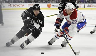 Los Angeles Kings center Michael Cammalleri, left, and Montreal Canadiens defenseman Karl Alzner vie for the puck during the second period of an NHL hockey game, Wednesday, Oct. 18, 2017, in Los Angeles. (AP Photo/Mark J. Terrill)