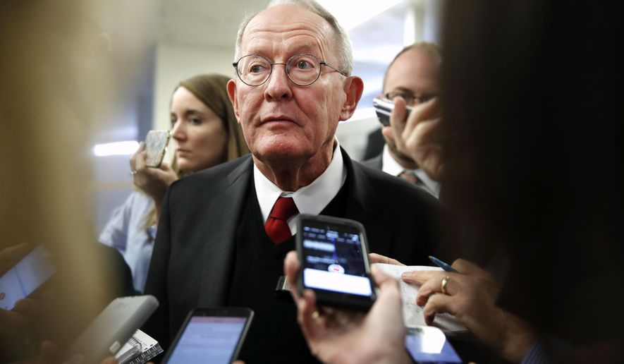 Sen. Lamar Alexander, R-Tenn., speaks to reporters as he heads to vote on budget amendments, Thursday, Oct. 19, 2017, in Washington. (AP Photo/Jacquelyn Martin)