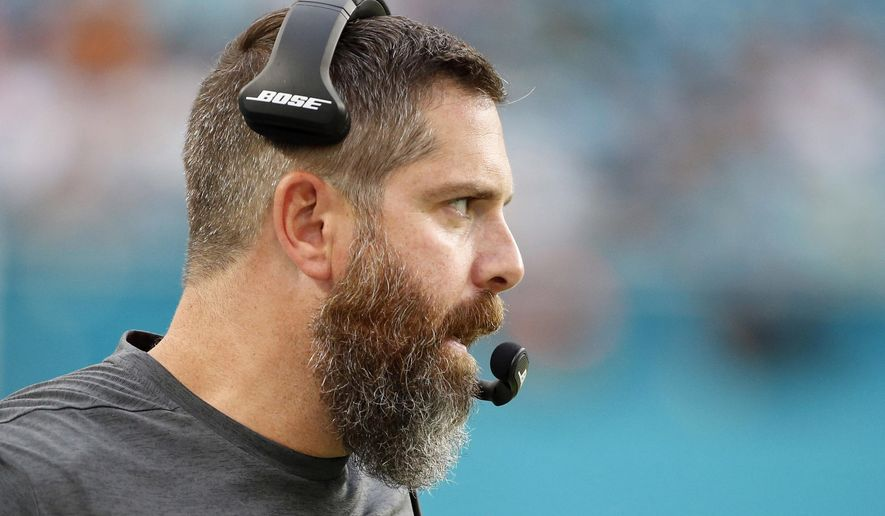 FILE - In this Aug. 17, 2017, file photo, Miami Dolphins defensive coordinator Matt Burke watches the game from the sidelines during the first half of an NFL preseason football game against the Baltimore Ravens in Miami Gardens, Fla. The Dolphins are winning with defense, and first-year coordinator Burke's unit should only improve as the season progresses.  (AP Photo/Wilfredo Lee, File)