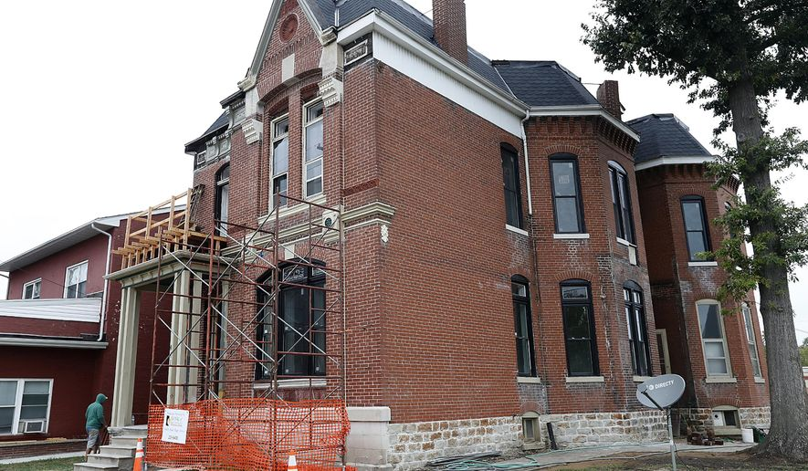 This Oct. 11, 2017 photo shows, the historic former home of architect Otto Rubach that is  being restored by businessmen Jason Buss and Dan Hamilton, in Belleville, Ill. The two men who own an antique store downtown have rescued Rubach's childhood home with a $150,000 makeover. While Rubach's former home was neglected, many of the buildings he designed have flourished, including the Belleville Public Library, (Steve Nagy/Belleville News-Democrat, via AP)