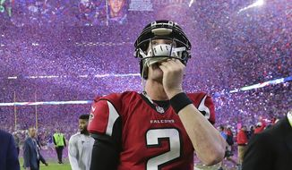 FILE - In this Feb. 5, 2017, file photo, Atlanta Falcons quarterback Matt Ryan reacts after losing Super Bowl 51 as the screen flashes New England Patriots quarterback Tom Brady and confetti flies in Houston.  The Falcons and Patriots have lived in two different realities since their Super Bowl matchup in February. New England has savored the memories of how it turned a 25-point second-half deficit into largest comeback victory in Super Bowl history. Meanwhile, Atlanta has had to live through a constant stream of internet memes and endless jokes about the seemingly insurmountable lead it let slip away. (Curtis Compton/Atlanta Journal-Constitution via AP, File)