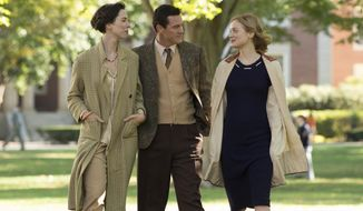 """This image released by Annapurna Pictures shows Rebecca Hall as Elizabeth Marston, from left, Luke Evans as Dr. William Marston and Bella Heathcote as Olive Byrne in """"Professor Marston and the Wonder Women."""" The film charts the unorthodox creation of Wonder Woman, which drew on Marston's research into sexuality and gender, as well as his own family: a threesome that harmoniously raised four children together. (Claire Folger/Annapurna Pictures via AP)"""