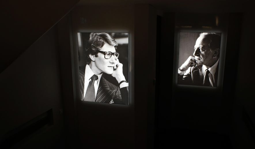 Pictures of French fashion designer Yves Saint Laurent, left, and Pierre Berge are displayed at the Yves Saint Laurent museum, in Paris, Thursday, Oct. 19, 2017. Less than three weeks since the inauguration of a Paris-based museum dedicated to him, The Yves Saint Laurent museum has opened its doors to the public in Marrakech, the Moroccan city beloved by the fashion designer. (AP Photo/Thibault Camus)