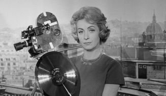 In this Dec. 27, 1959, file photo, French actress and singer Danielle Darrieux holds up a prop gold record at the Paris Saint-Maurice studios. Darrieux, a prolific French actress whose movie and theater career spanned eight decades, has died. She was 100. (AP Photo, File)