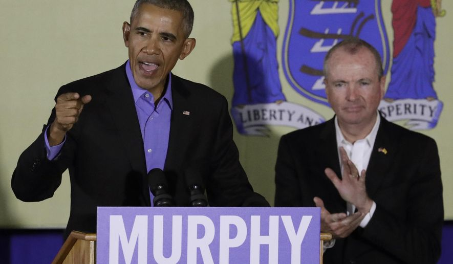 Former President Barack Obama, left, speaks during a canvassing event for New Jersey Democratic gubernatorial nominee Phil Murphy, right, Thursday, Oct. 19, 2017, in Newark, N.J. (AP Photo/Julio Cortez)