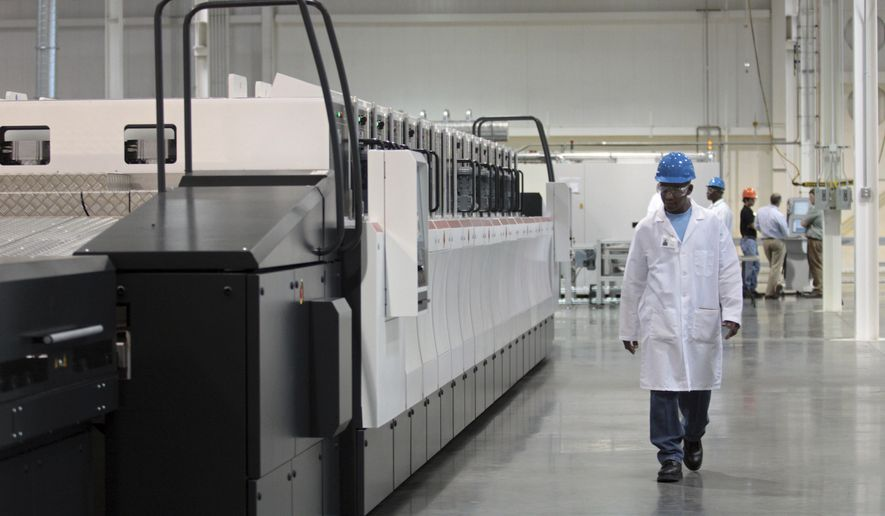 FILE - In this Sept. 16, 2011, file photograph, an employee walks past part of the production line at the Stion global manufacturing facility in Hattiesburg, Miss. The company, which produces solar panels, was expected to bring about 1,000 jobs to Mississippi once it began manufacturing at full capacity, but instead notified the state Tuesday, Oct. 17, 2017, that it would close its Hattiesburg plant Dec. 13. Mississippi initially loaned Stion $74.8 million, and governments have given millions more in other tax breaks and subsidies. (Bryant Hawkins/Hattiesburg American, via AP, File)