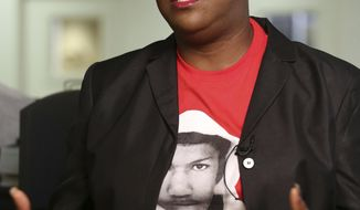 FILE- This Feb. 25, 2015 file photo shows Sybrina Fulton, mother of Trayvon Martin, in Miami. Fulton is against a line of insurance offered by the NRA for gun owners to cover not only civil liability but costs associated with any criminal charges whenever a gun owner uses their firearm in what they call a self-defense or stand your ground case. (AP Photo/Marta Lavandier, File)