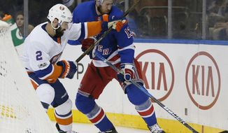 New York Islanders defenseman Nick Leddy (2) defends New York Rangers center Kevin Hayes (13) during the second period of an NHL hockey game in New York, Thursday, Oct. 19, 2017. (AP Photo/Kathy Willens)