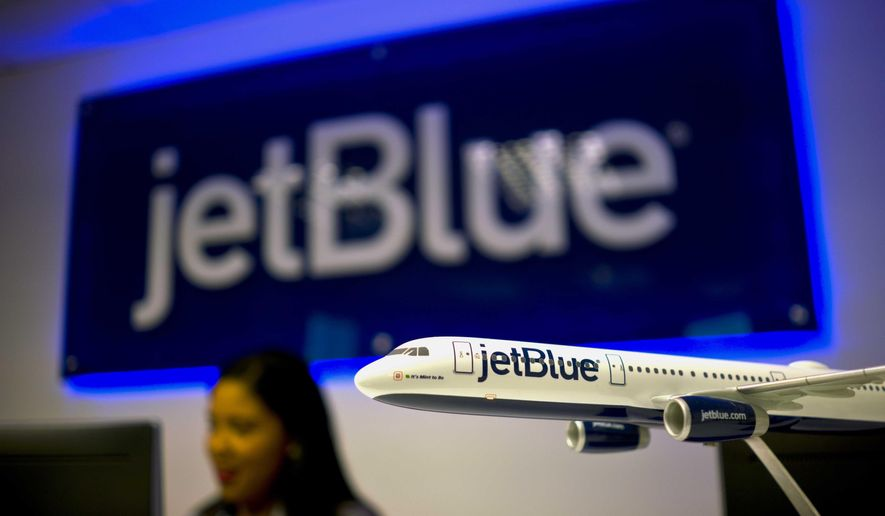 FILE - In this Friday, Sept. 1, 2017, file photo, a flight attendant works in the newly opened JetBlue office in Havana, Cuba. JetBlue Airways Corp. said Thursday, Oct. 19, 2017, that the company will stop selling tickets on a dozen discount travel websites in hopes of driving customers to the airline's site and reducing the company's costs. (AP Photo/Ramon Espinosa, File)