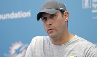FILE - In this Oct. 9, 2017, file photo, Miami Dolphins head coach Adam Gase talks to reporters during a news conference, in Davie, Fla. The Dolphins rank last in the NFL in half a dozen major offensive categories and have been outgained by 363 yards this season, yet because they keep winning close games, only three teams in the AFC have a better record. The Dolphins take on the New York Jets on Sunday.  (AP Photo/Alan Diaz)