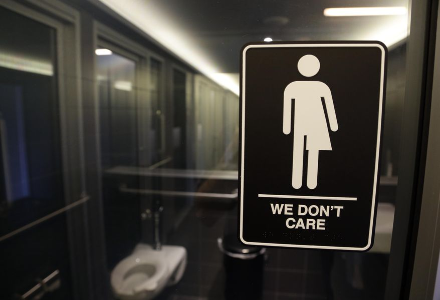 In this May 12, 2016, file photo, signage is seen outside a restroom at 21c Museum Hotel in Durham, N.C. (AP Photo/Gerry Broome, File)