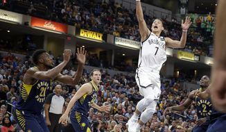 Brooklyn Nets guard Jeremy Lin (7) shoots over Indiana Pacers forward Thaddeus Young (21) during the second half of an NBA basketball game in Indianapolis, Wednesday, Oct. 18, 2017. The Pacers defeated the Nets 140-131 (AP Photo/Michael Conroy)