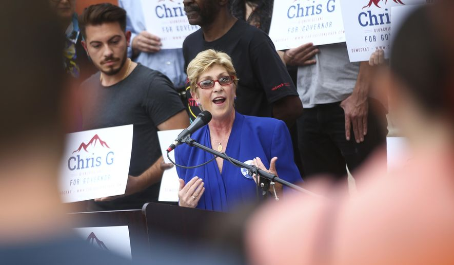 In a Wednesday, Oct. 18, 2017 photo, Clark County Commissioner Chris Giunchigliani announces her campaign for governor outside of Las Vegas Academy in downtown Las Vegas.  Giunchigliani says she'll run as a Democrat for Nevada governor in November 2018. (Chase Stevens/Las Vegas Review-Journal via AP)