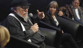 Author and film producer George R. R. Martin, left, speaks in Santa Fe, N.M., Thursday, Oct. 19, 2017. Martin waded into the politics of movie-industry tax breaks on Thursday while endorsing a prominent Democratic candidate for governor of New Mexico. (AP Photo/Morgan Lee)