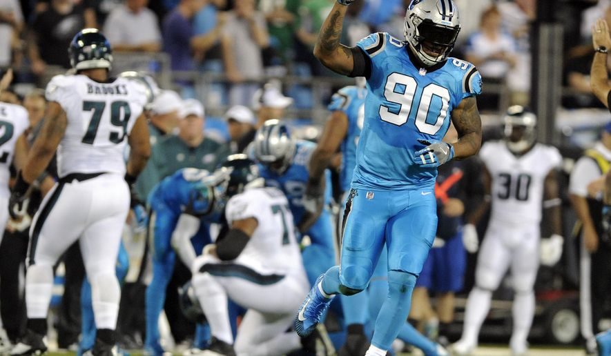 FILE - In this Thursday, Oct. 12, 2017, file photo, Carolina Panthers' Julius Peppers (90) celebrates his sack of Philadelphia Eagles' Carson Wentz in the first half of an NFL football game in Charlotte, N.C. Veteran DE Julius Peppers has 6 and ahalf sacks in six games since his return to Carolina. (AP Photo/Mike McCarn, File)