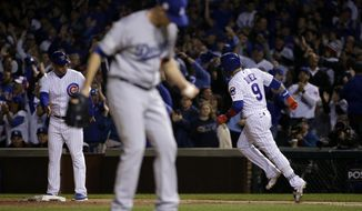 Los Angeles Dodgers' Alex Wood reacts as Chicago Cubs' Javier Baez (9) runs the base after hitting a home run during the second inning of Game 4 of baseball's National League Championship Series, Wednesday, Oct. 18, 2017, in Chicago. (AP Photo/Nam Y. Huh)