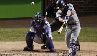 Los Angeles Dodgers' Enrique Hernandez (14) hits a home run off Chicago Cubs starting pitcher Jose Quintana during the second inning of Game 5 of baseball's National League Championship Series, Thursday, Oct. 19, 2017, in Chicago. (AP Photo/Charles Rex Arbogast)