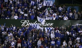 Fans celebrates after Game 4 of baseball's National League Championship Series between the Chicago Cubs and the Los Angeles Dodgers, Wednesday, Oct. 18, 2017, in Chicago. The Cubs won 3-2. (AP Photo/Nam Y. Huh)