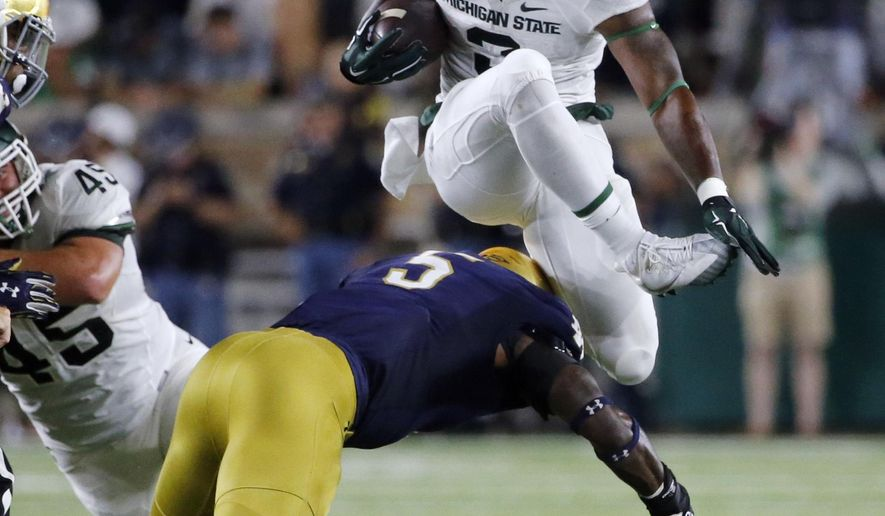 Mich St RB Scott charged with driving on suspended license