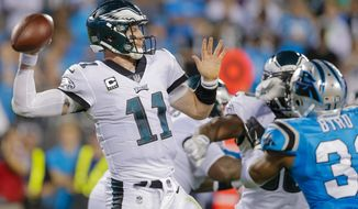 FILE - In this Thursday, Oct. 12, 2017 file photo, Philadelphia Eagles' Carson Wentz (11) aims a pass against the Carolina Panthers during the second half of an NFL football game in Charlotte, N.C. The Eagles play the Washington Redskins on Monday, Oct. 23, 2017. (AP Photo/Bob Leverone, File)