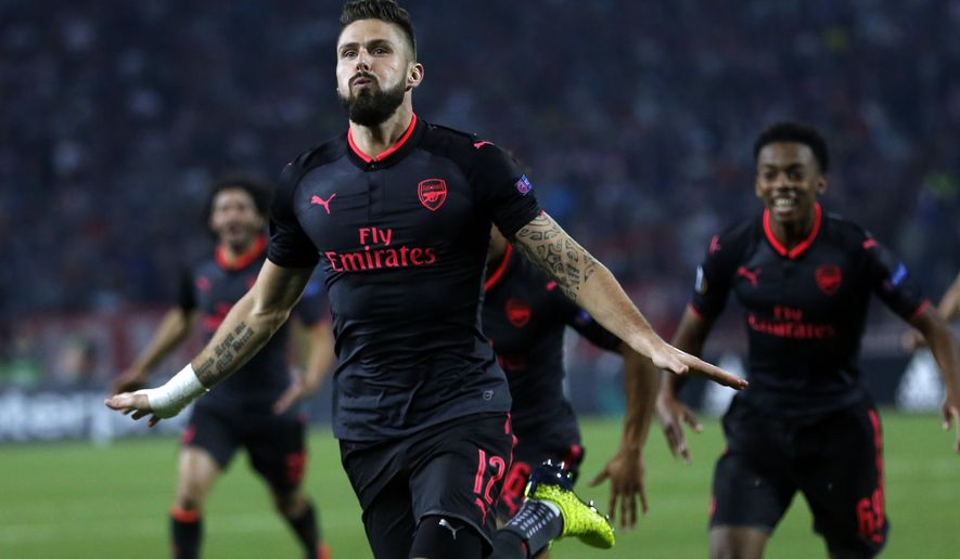 Arsenal's Olivier Giroud celebrates scoring his side's first goal of the game during the Europa League group H soccer match between Red Star and Arsenal on the stadium Rajko Mitic in Belgrade, Serbia, Thursday, Oct. 19, 2017. (AP Photo/Darko Vojinovic)