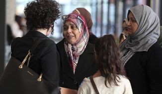 Supporters of Abdella Ahmad Tounisi leave the Dirksen U.S. Courthouse in Chicago on Thursday, Oct. 19, 2017, after Tounisi was sentenced to 15 years in prison for attempting to join an al-Qaida-linked group fighting Bashar Assad's regime in Syria. (Terrence Antonio James/Chicago Tribune via AP)