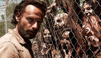"Rick Grimes meets ""The Walking Dead."" (Couretsy AMC)"