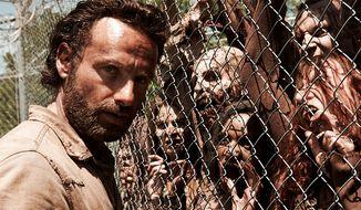 "Rick Grimes meets ""The Walking Dead."" (Couretsy AMC)"