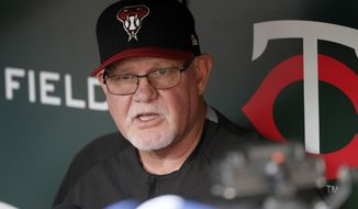 FILE - In this Friday, Aug. 18, 2017 file photo, former Minnesota Twins manager and present an Arizona Diamondbacks coach Ron Gardenhire visits with the media in the visitor's dugout prior to a baseball game between the two teams in Minneapolis. A person with knowledge of the discussions says the Detroit Tigers are in talks to hire Ron Gardenhire as manager. The person spoke on condition of anonymity Thursday, Oct. 19, 2017 because no announcement had been made.(AP Photo/Jim Mone, File)