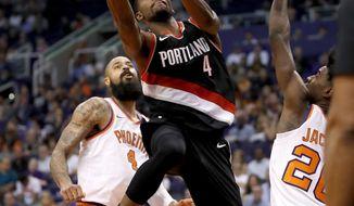 Portland Trail Blazers forward Maurice Harkless (4) shoots as Phoenix Suns forward Josh Jackson (20) defends and center Tyson Chandler (4) watches during the second half of an NBA basketball game, Wednesday, Oct. 18, 2017, in Phoenix. (AP Photo/Matt York)