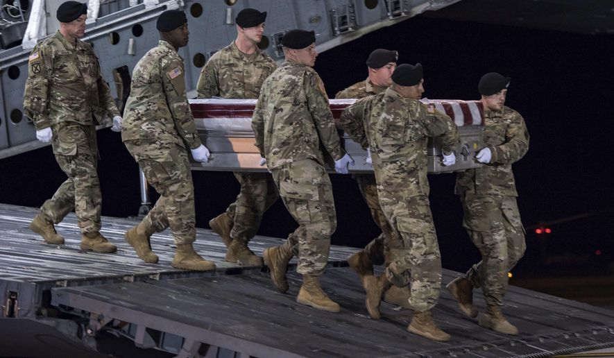 In this image provided by the U.S. Army, a carry team of soldiers from the 3d U.S. Infantry Regiment (The Old Guard), carry the transfer case during a casualty return for Staff Sgt. Dustin M. Wright, of Lyons, Ga., at Dover Air Force Base, Del., Oct. 5, 2017. U.S. and Niger forces were leaving a meeting with tribal leaders when they were ambushed on Oct. 4 and Wright and three other soldiers were killed. There were about a dozen U.S. troops and a company of Niger forces, for a total of about 40 service members in the joint mission. (Pfc. Lane Hiser/U.S. Army via AP)