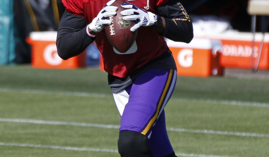 Minnesota Vikings quarterback Teddy Bridgewater works out during NFL football practice Thursday, Oct. 19, 2017, in Eden Prairie, Minn. He was cleared to rejoin the team Wednesday on the field where he dislocated his left knee and tore multiple ligaments in a non-contact drill less than two weeks before the 2016 season began. (AP Photo/Jim Mone)