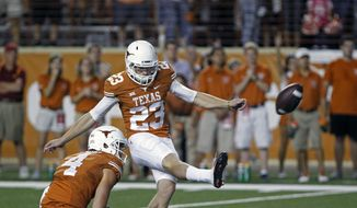 Texas' Nick Rose (23) kicks the winning field goal during the fourth quarter of an NCAA college football game against Iowa State in Austin, Texas, Saturday, Oct. 18, 2014. The holder is punter William Ross (4). Texas won 48-45. (AP Photo/Michael Thomas)