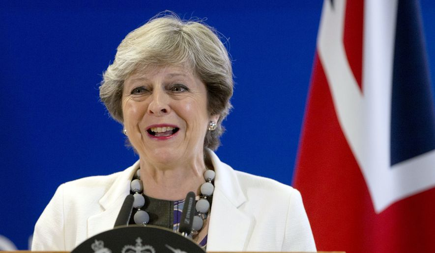 British Prime Minister Theresa May Theresa May speaks during a media conference at an EU summit in Brussels on Friday, Oct. 20, 2017. European Union leaders gathered Friday to weigh progress in negotiations on Britain's departure from their club as they look for new ways to speed up the painfully slow moving process. (AP Photo/Virginia Mayo)