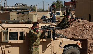 "Kurdish security forces stand guard in their defensive positions in Altun Kupri, outskirts of Irbil, Iraq, Thursday Oct. 19. 2017.  A Baghdad court issued an arrest warrant for  Kosrat Rasul, the vice president of Iraq's autonomous northern Kurdish region on Thursday for saying that Iraqi forces had ""occupied"" the disputed province of Kirkuk this week. (AP Photo/Khalid Mohammed)"