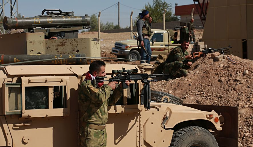 """Kurdish security forces stand guard in their defensive positions in Altun Kupri, outskirts of Irbil, Iraq, Thursday Oct. 19. 2017.  A Baghdad court issued an arrest warrant for  Kosrat Rasul, the vice president of Iraq's autonomous northern Kurdish region on Thursday for saying that Iraqi forces had """"occupied"""" the disputed province of Kirkuk this week. (AP Photo/Khalid Mohammed)"""