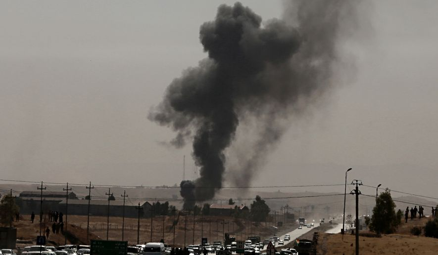 Iraqi federal and Kurdish forces exchanged fire at their shared border on Friday, capping a dramatic week of maneuvers. (Associated Press/File)
