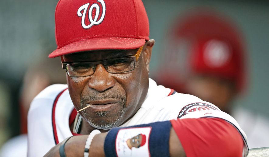 FILE - In this Sept. 13, 2016, file photo, Washington Nationals manager Dusty Baker pauses in the dugout before a baseball game against the New York Mets at Nationals Park in Washington. The Nationals announced Friday, Oct. 20, 2017, that Baker won't be back next season. Baker led the Nationals to the NL East title in each of his two years with the club. But Washington lost its NL Division Series both times. (AP Photo/Alex Brandon, File)