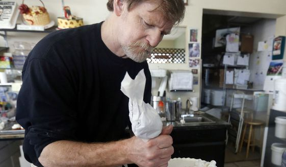 Masterpiece Cakeshop owner Jack Phillips decorates a cake inside his store in Lakewood, Colo.  Prominent chefs, bakers and restaurant owners want the Supreme Court to rule against a Colorado baker who wouldn't make a cake for a same-sex couple's wedding. The food makers say that once they open their doors for business, they don't get to choose their customers.  (AP Photo/Brennan Linsley, File)