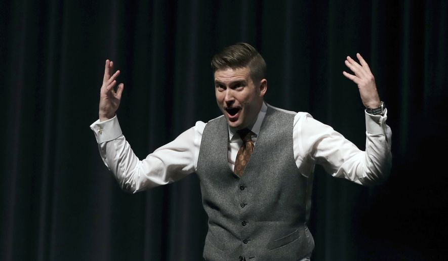White Nationalist Richard Spencer tries to get students to shout louder as they clash during a speech Thursday, Oct. 19, 2017, at the University of Florida in Gainesville. (AP Photo/Chris O'Meara)