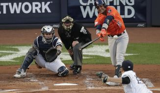 Houston Astros' Yuli Gurriel hits a double during the second inning of Game 5 of baseball's American League Championship Series against the New York Yankees Wednesday, Oct. 18, 2017, in New York. (AP Photo/Frank Franklin II)
