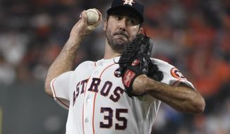 Houston Astros starting pitcher Justin Verlander throws during the second inning of Game 6 of baseball's American League Championship Series against the New York Yankees Friday, Oct. 20, 2017, in Houston. (AP Photo/Eric Christian Smith)